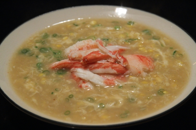 Corn and crab soup, with egg and smoked pepper