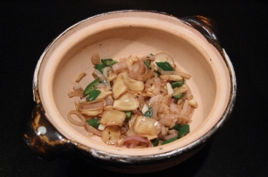Garlic, shallots, ginger, and chiles, in the clay pot