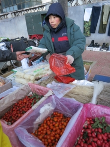 At the farmer's market, buying noodles and tomatoes