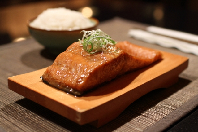 Baked salmon with a glaze made from Xiaoxing rice wine, soy sauce, and sesame oil