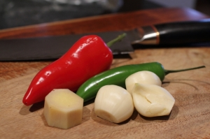 Red jalapeño, green serrano chile, garlic, and ginger