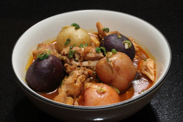 Braised chicken with small potatoes and spices from western China