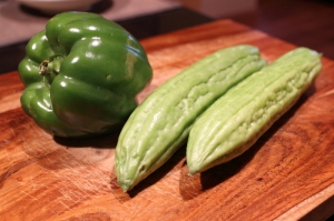 From lest to right: one green bell pepper and two bitter melons