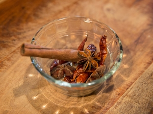 Dried spices, including cinnamon, dried red chiles, and star anise
